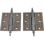 Ornate Victorian iron hinges with steeple tips