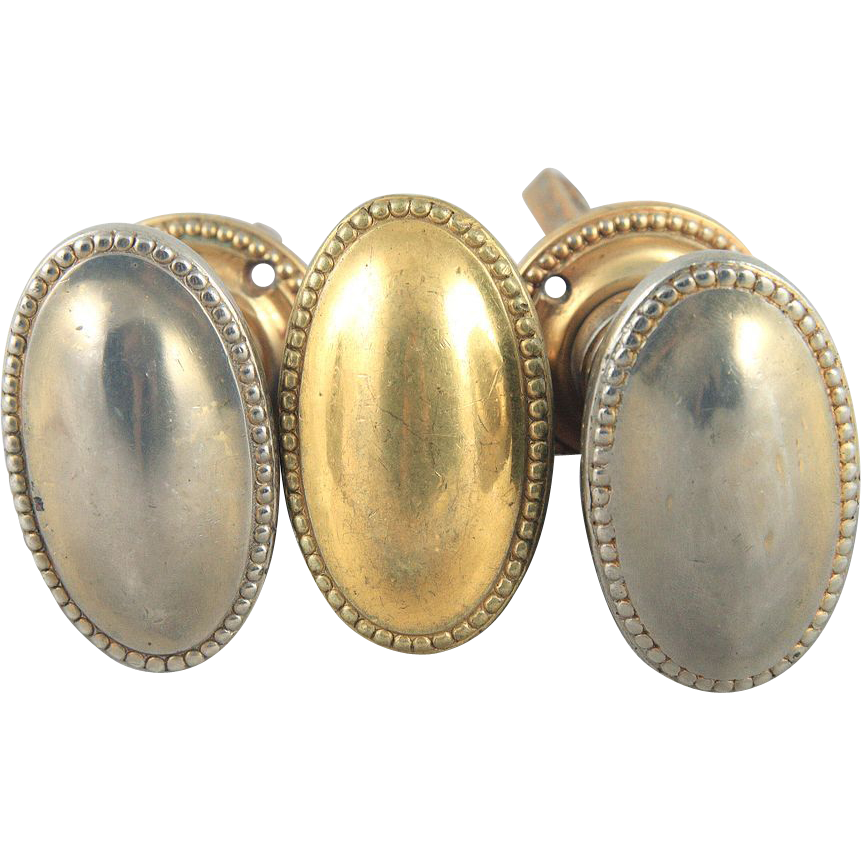 Vintage gold and sliver colored oval beaded edge knob set