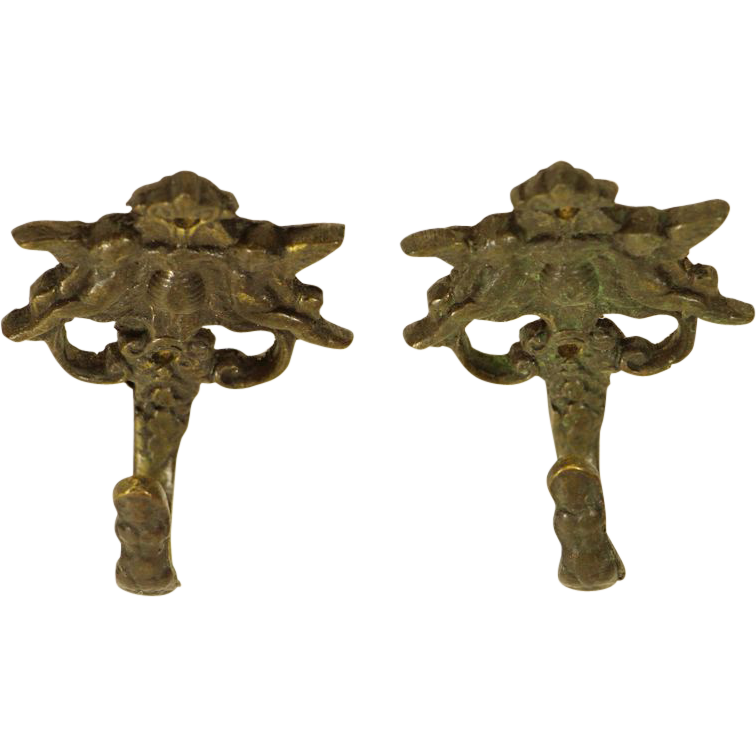 Set of cast bronze angel hooks