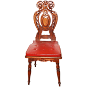 Set of four wooden carved chairs with vinyl upholstery