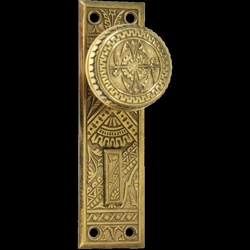 Brass Eastlake knob and plate set