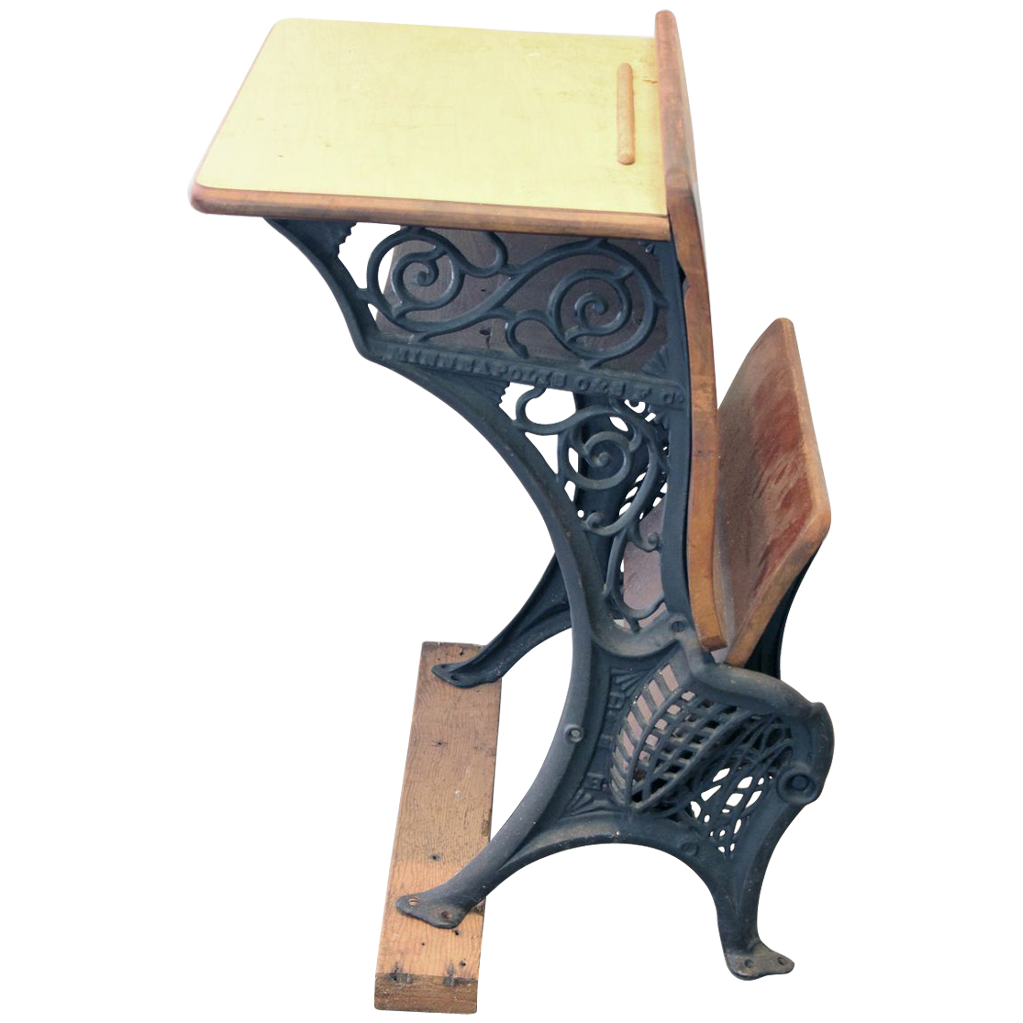 Old fashioned school desk with decorative iron legs