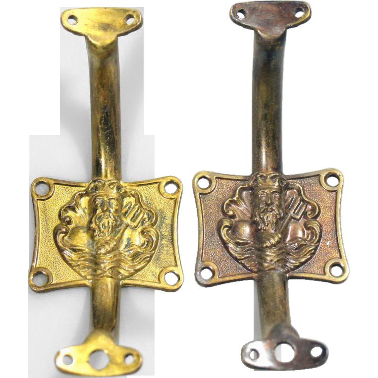 Pair of figural Poseidon brass pulls