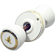 Original gold leaf porcelain knob set with matching switch plate