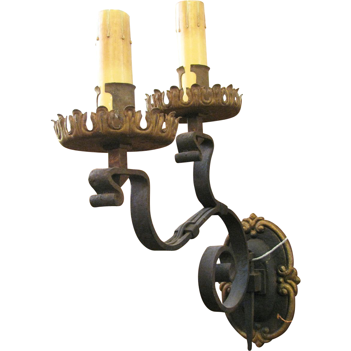 Pair of two armed wrought iron sconces