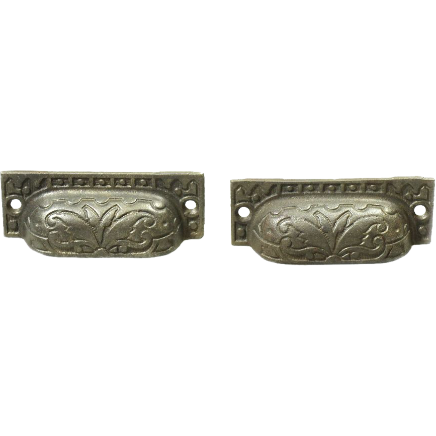 Pair of cast iron ornate bin pulls