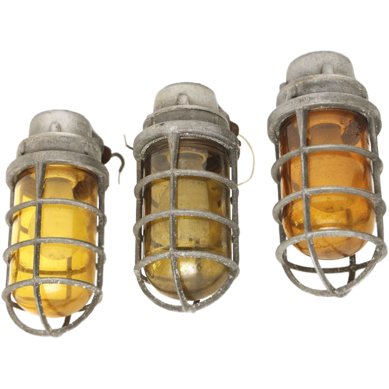 Vintage cast aluminum nautical sconces with amber glass