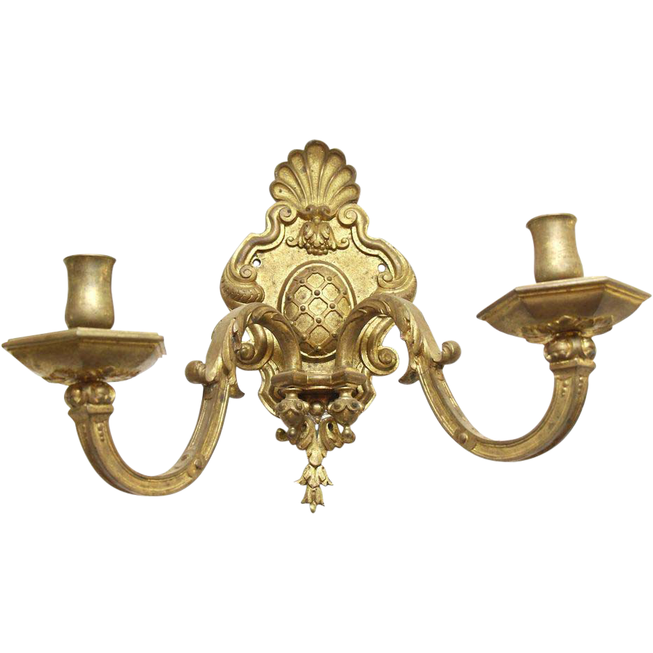 Pair of brass two arm sconces with original patina