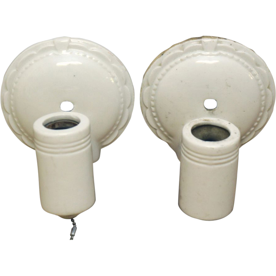 Pair of vintage scalloped edge white porcelain sconces