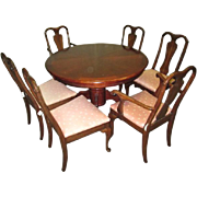 Dining set with walnut veneer