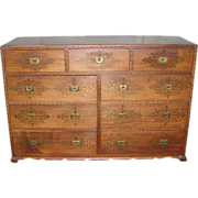Wooden dresser with inlaid brass detail