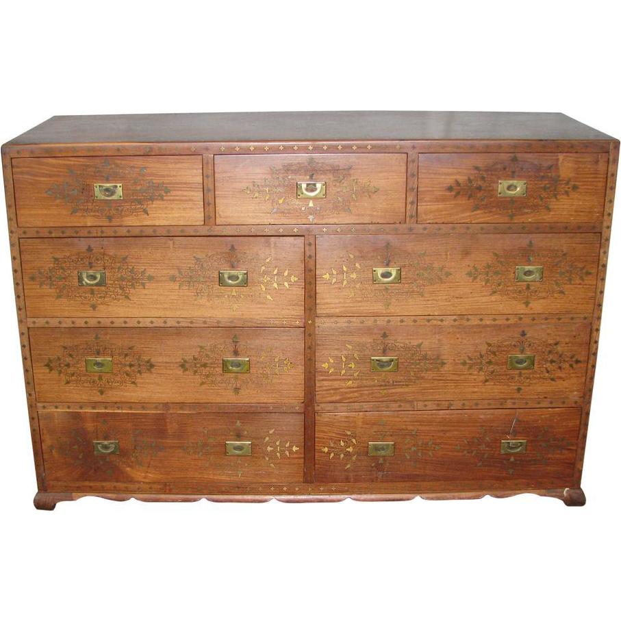 Wooden dresser with inlaid brass detail