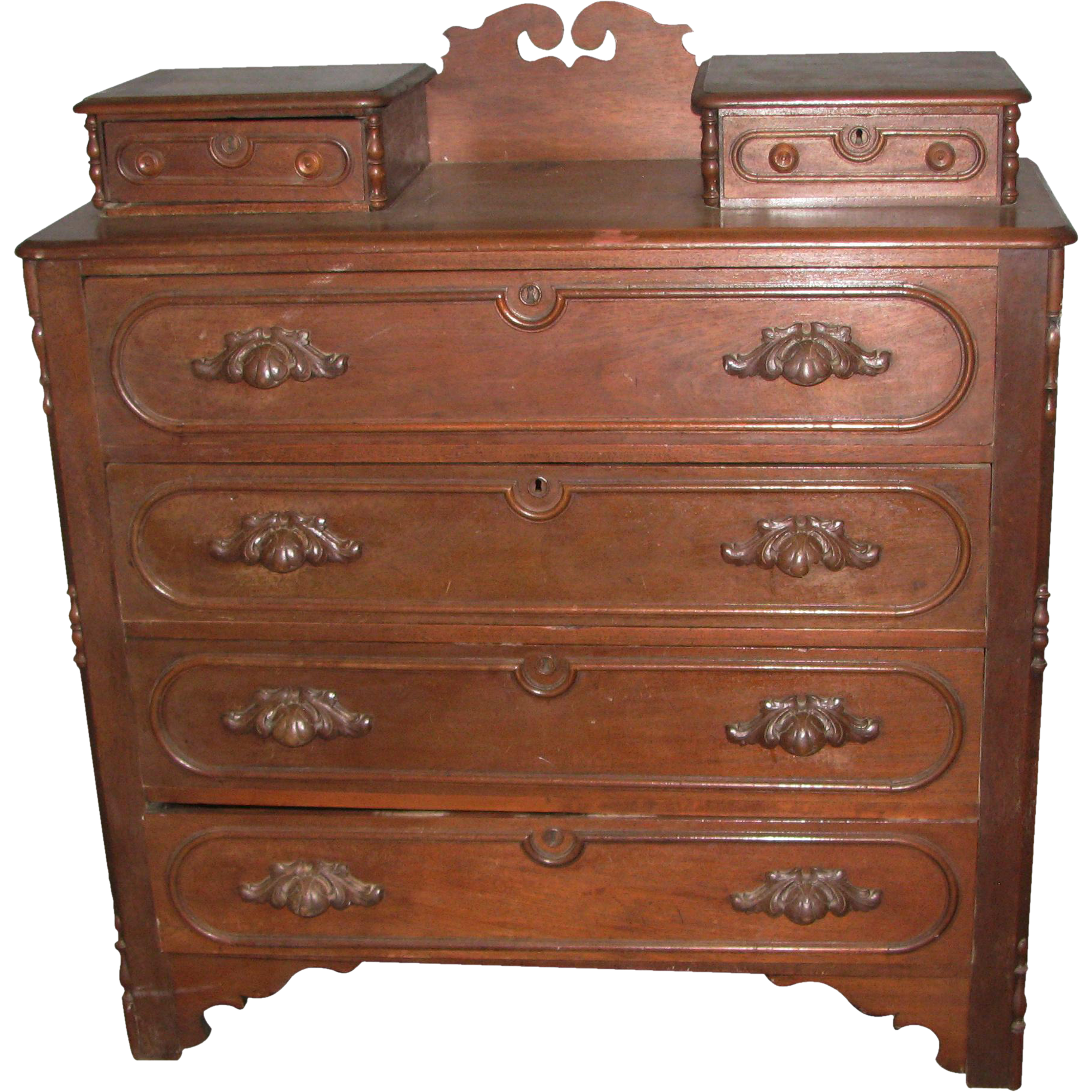 19th century walnut dresser with carved wood handles
