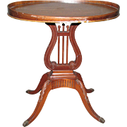 1940s Mahogany table with harp motif