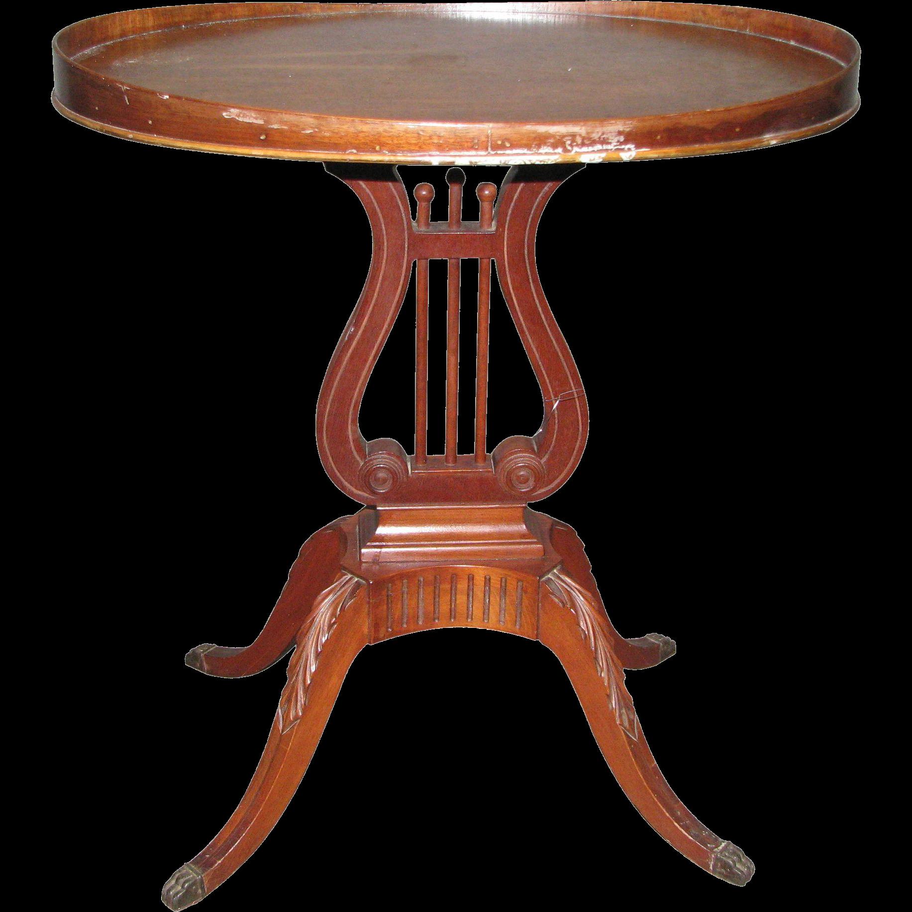 1940s Mahogany table with harp motif