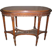 Antique carved wooden table with marble top