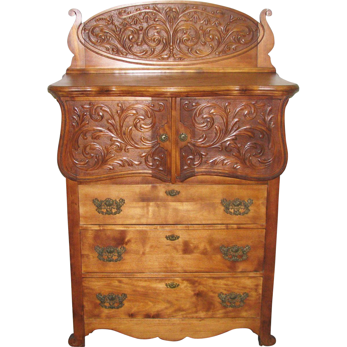 Intricately carved flamed maple dresser