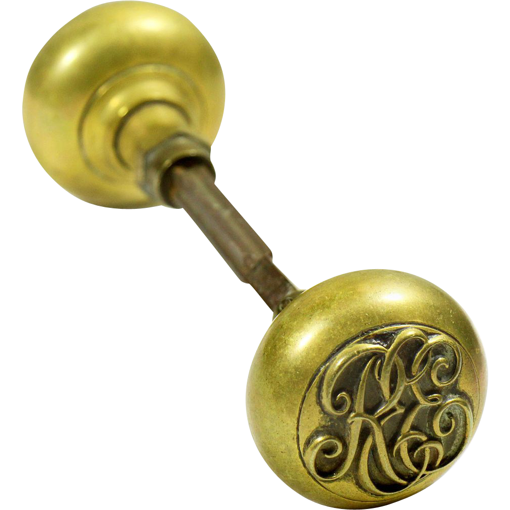 Emblematic brass knob with elegant lettering