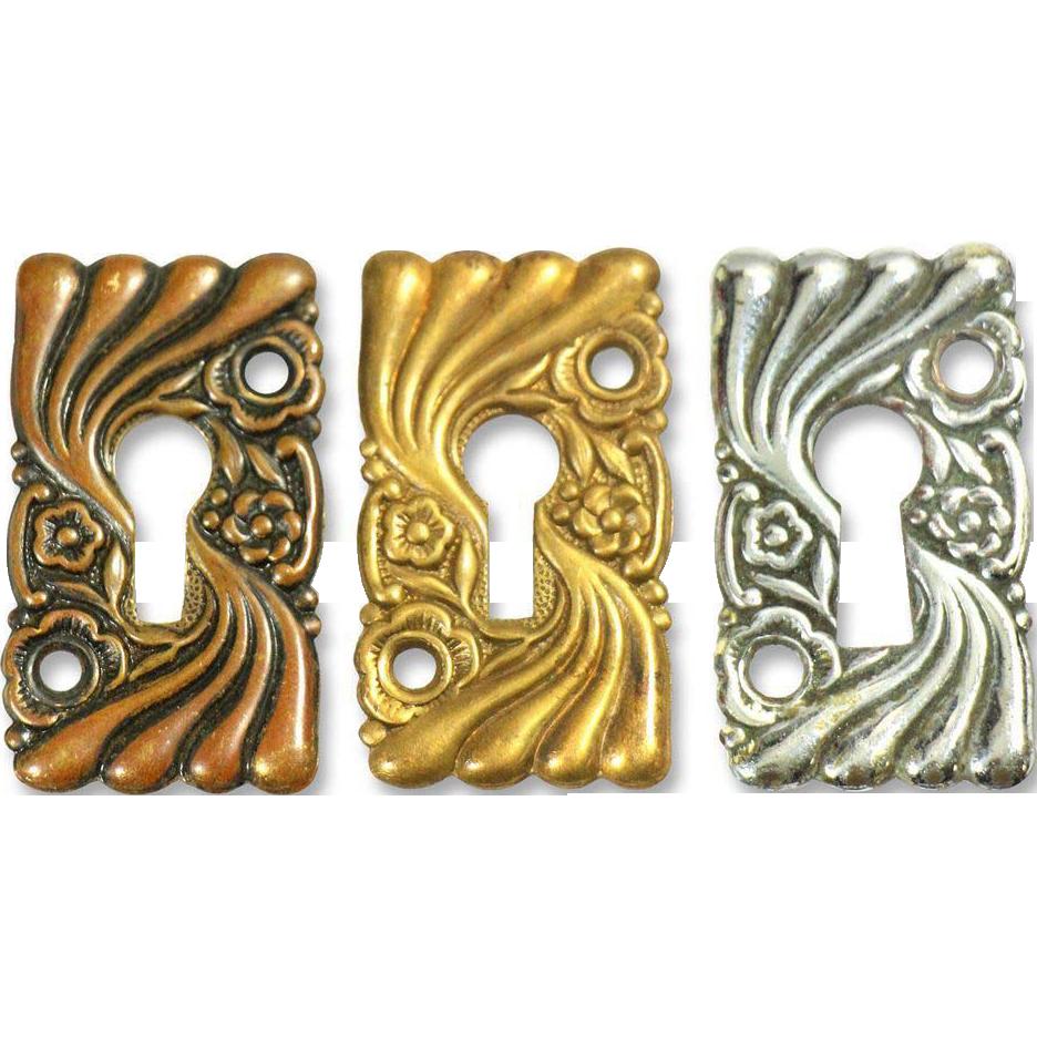 Set of Art Nouveau wavy floral key hole covers