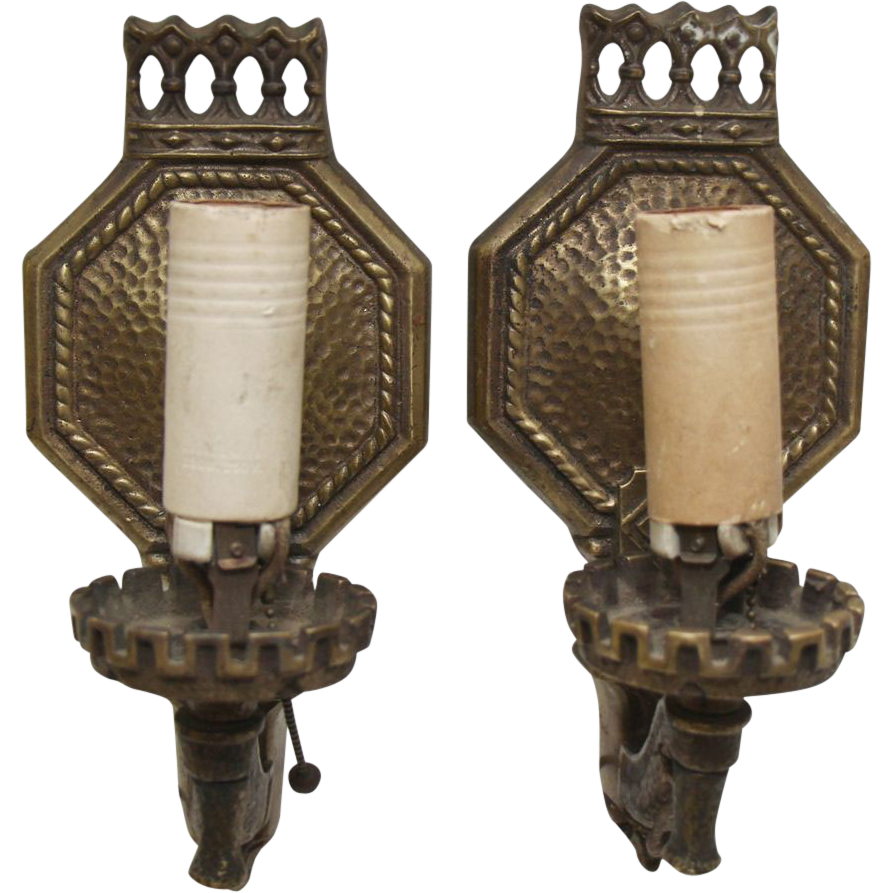 Pair of turn of the century hammered bronze one arm sconces