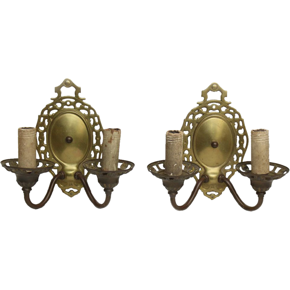 Early 20th century ornate cast brass sconces