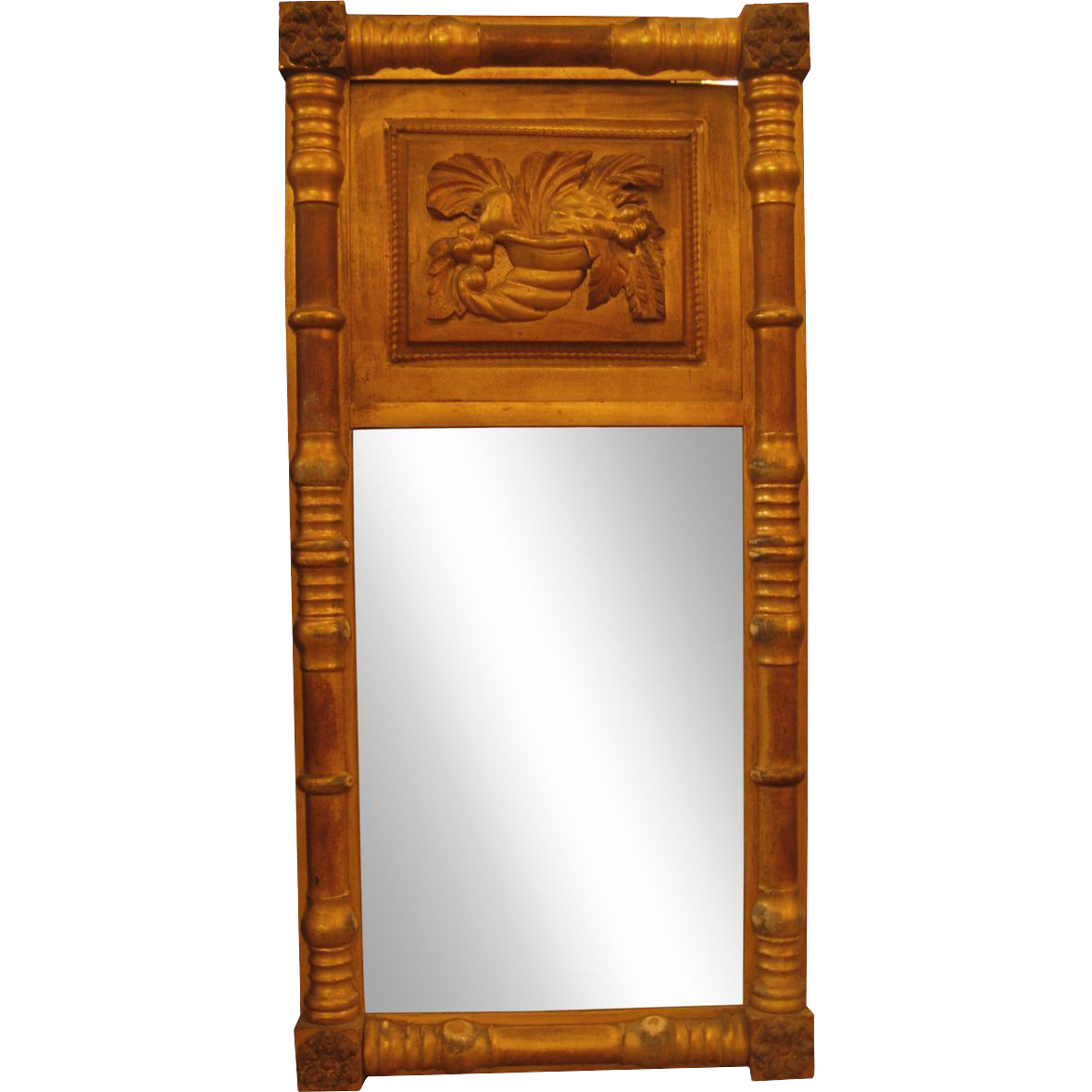 Early  gold colored wooden frame mirror