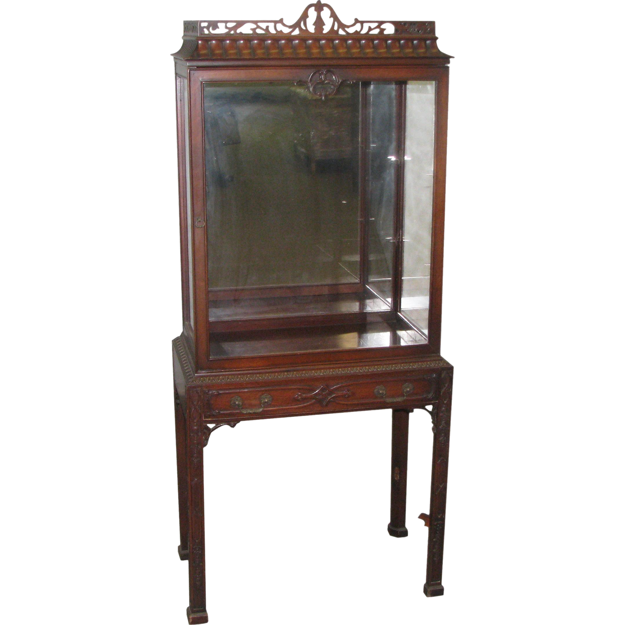 Petite mahogany vitrine with carved details