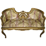 19th century ornately carved wood framed French settee