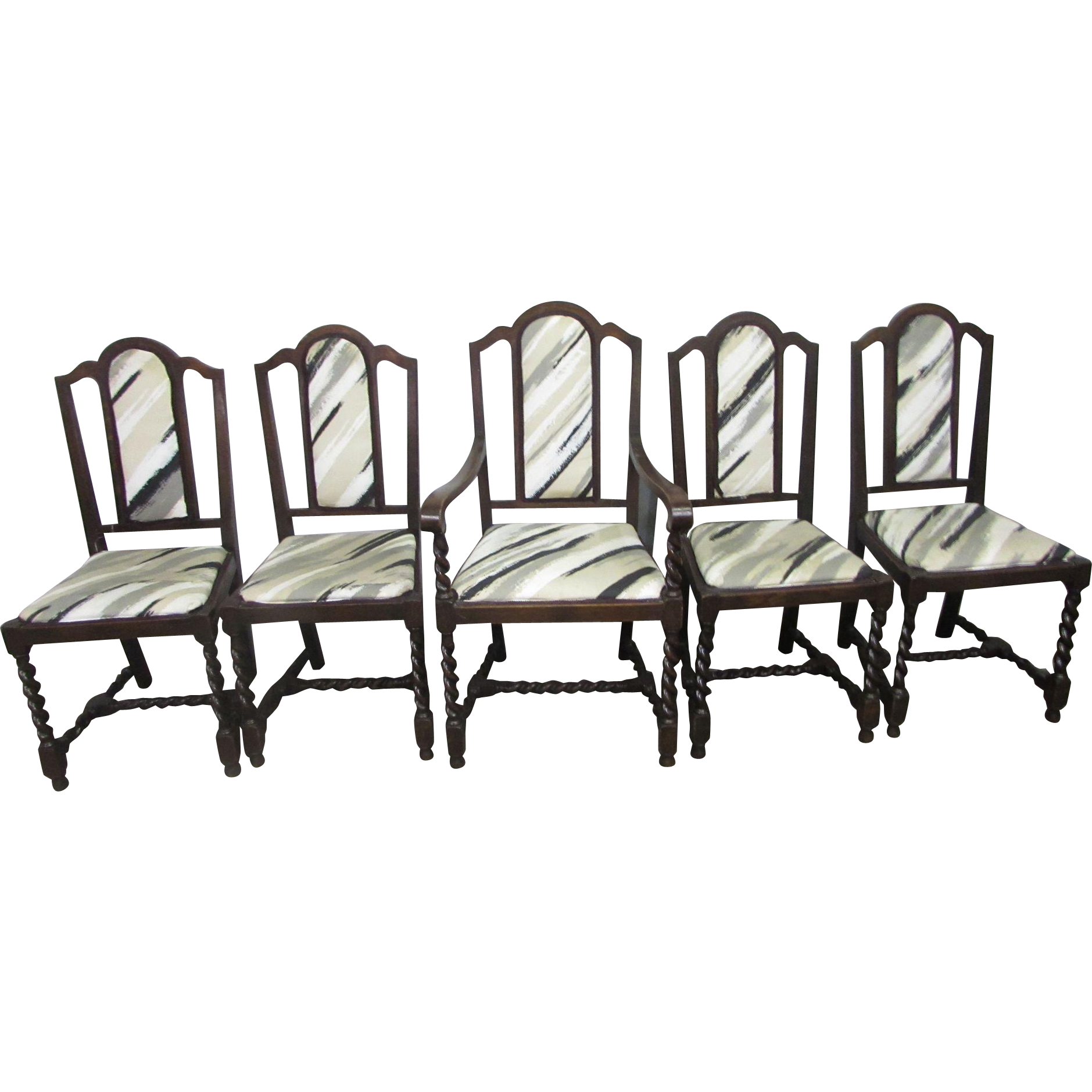 Set of carved wooded dining chairs with serpentine legs