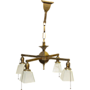 Four arm brass chandelier with white glass shades