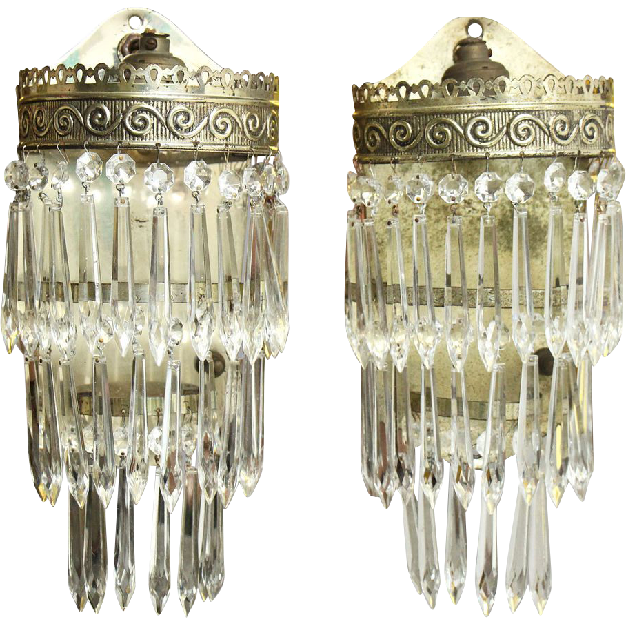 Pair of crystal three tiered sconces