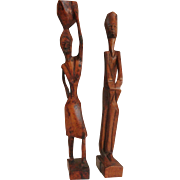 Pair of hand carved wooden African sculptures