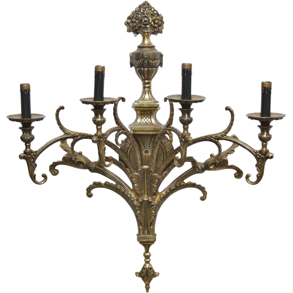 Pair of ornate gold colored four arm sconces