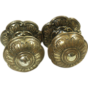 Ornate brass floral knob set