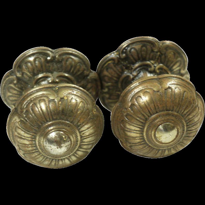 Ornate brass floral knob set