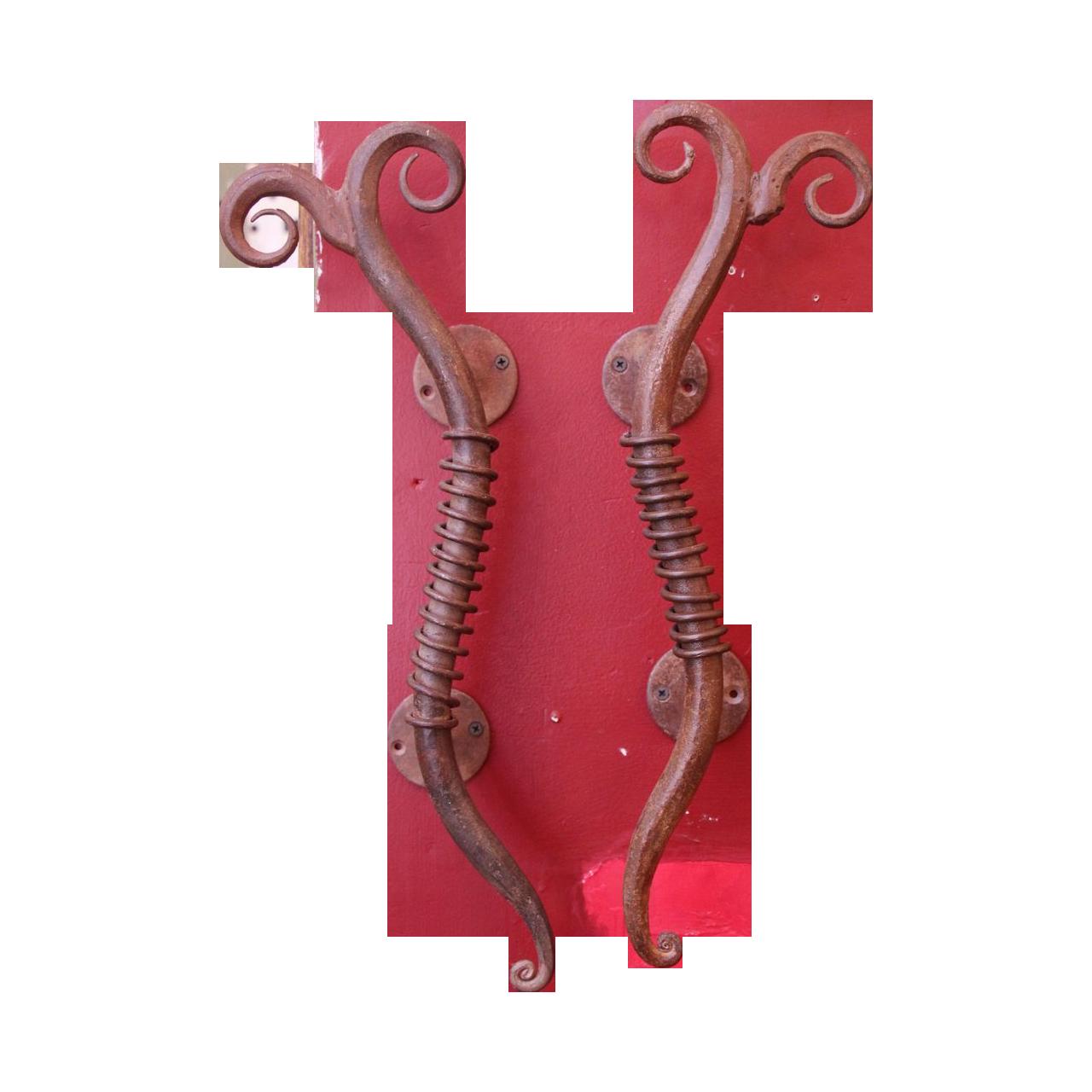 Pair of unique bronze door pulls