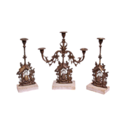 Set of three figural table candelabras