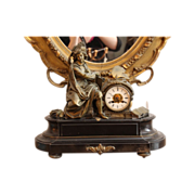 Figural mantel clock with bronze parts