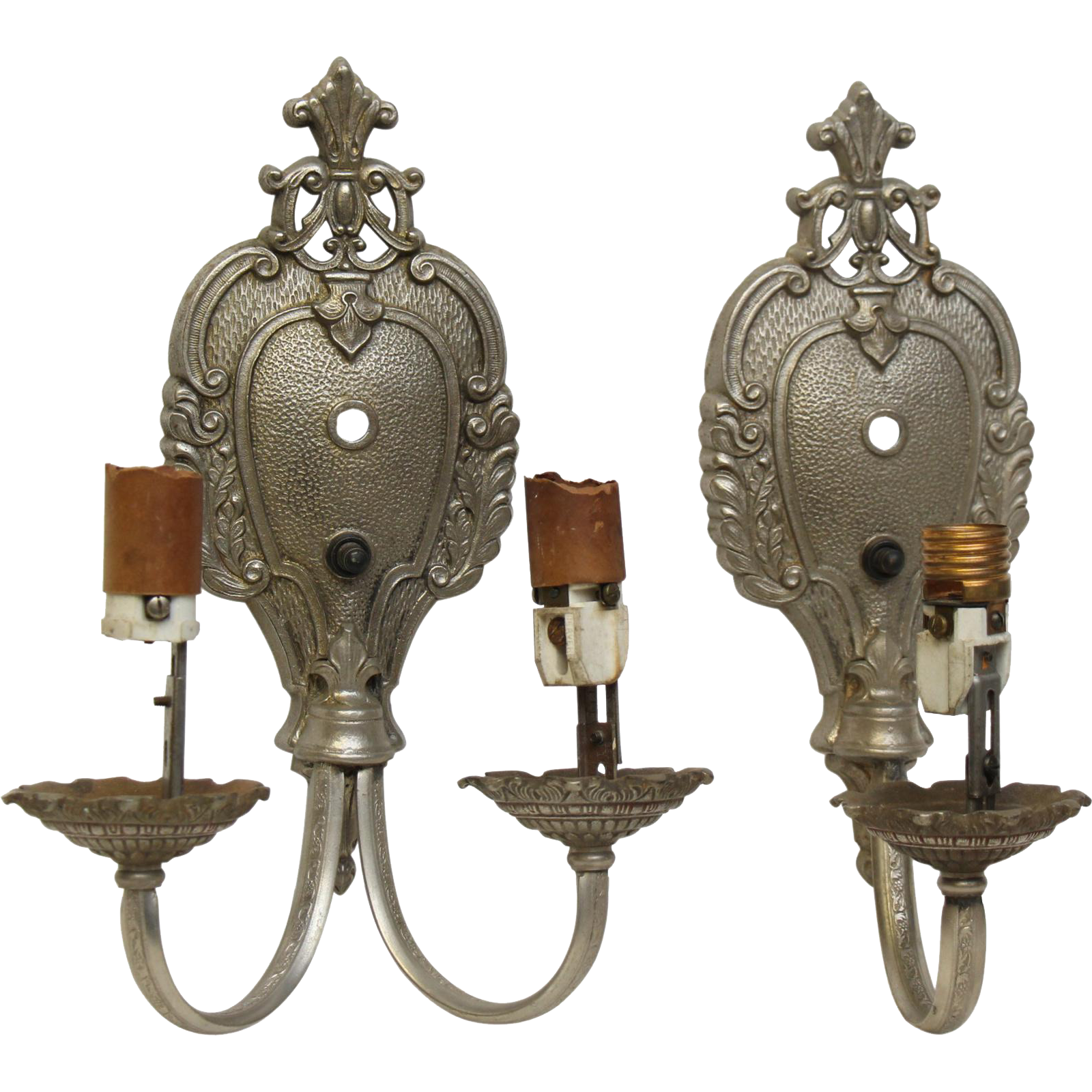 Turn of the century set of cast iron sconces with nickel finish