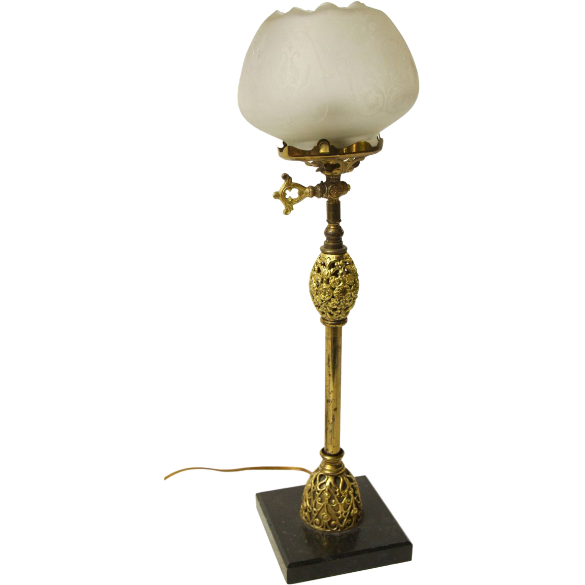 Pretty ornate table lamp with glass shade