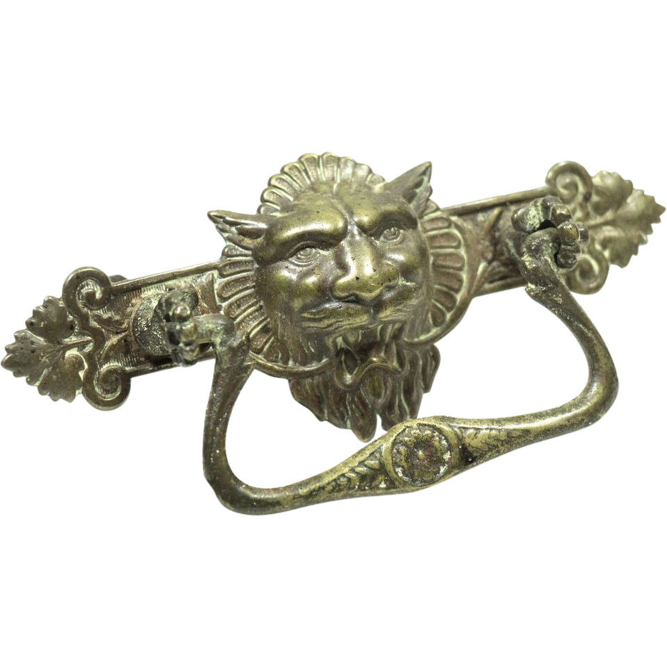Set of pressed brass lion head drawer pulls