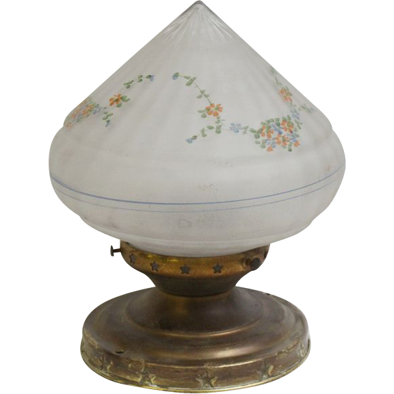 Floral glass shade with brass fixture and star detail