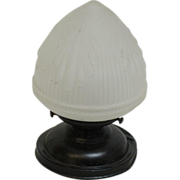 Flush mount light with acorn globe