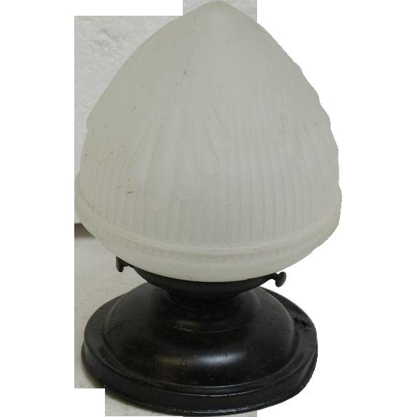 Flush mount light with acorn globe