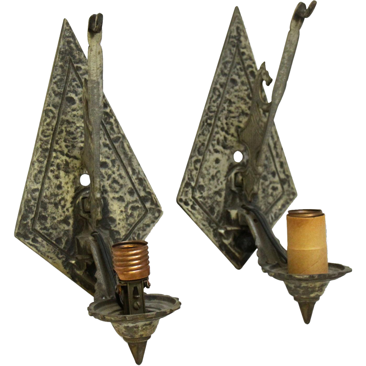 Pair of Tudor figural hammered sconces