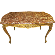 Rococo marble top desk with ornate legs