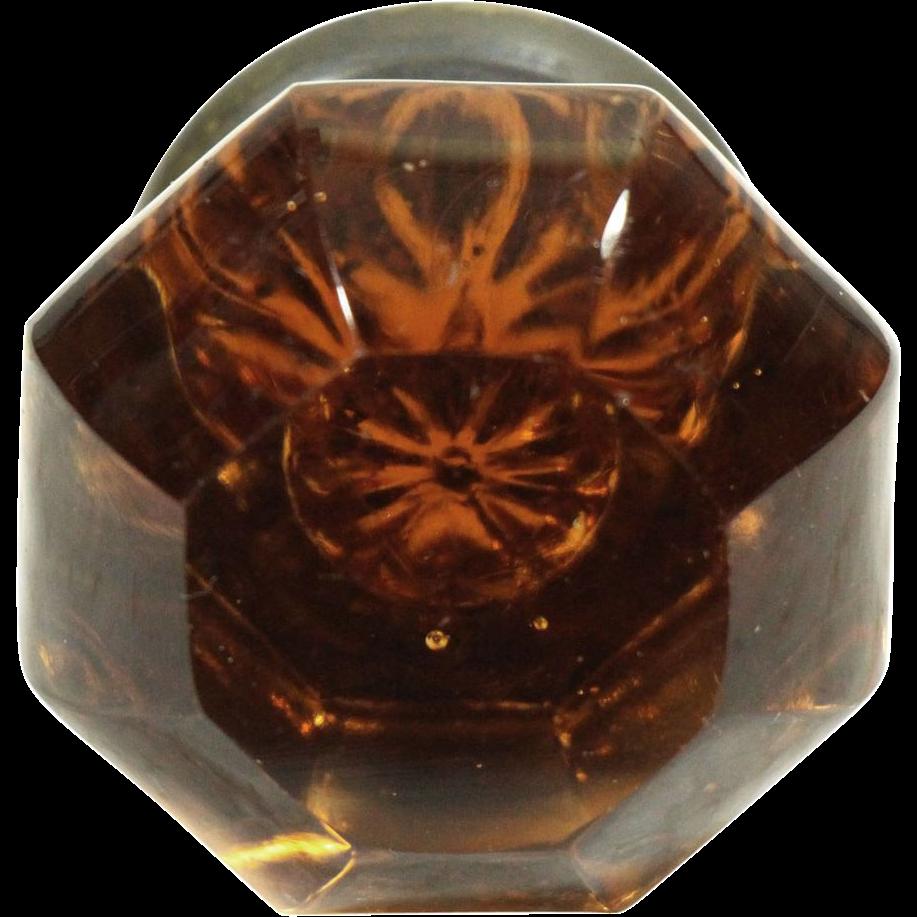 Dark amber colored glass knob