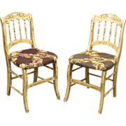 Turn of the century worn floral chairs