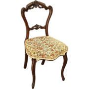 Single floral cushion carved chair