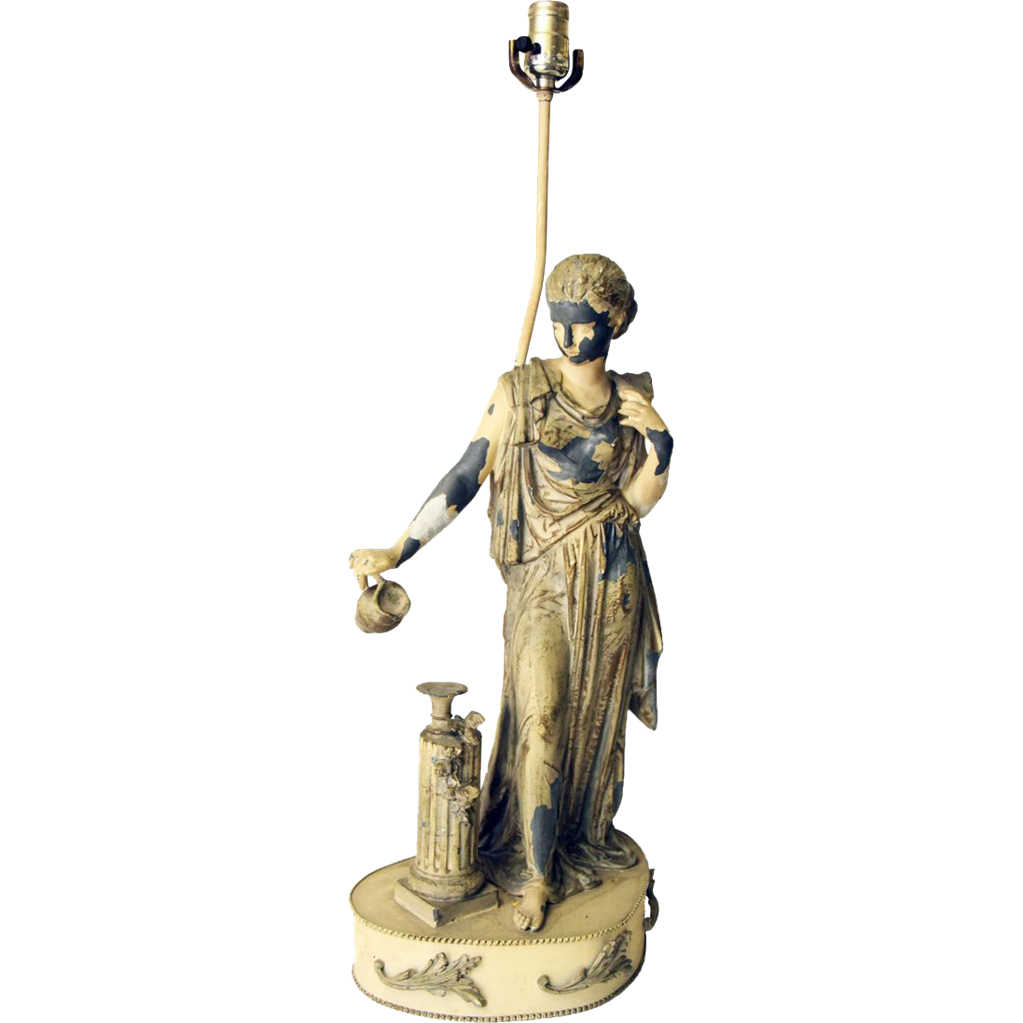 Cast metal figural lamp